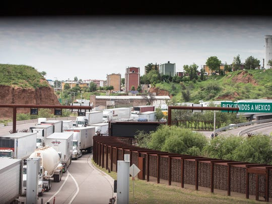 A long line of trucks waits to be checked by U.S. Customs
