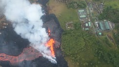 Lava erupts and flows from a Kilauea volcano fissure,