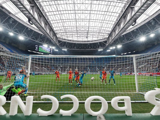 Zenit's Branislav Ivanovic scores during the Russian national championship match between Zenit St.Petersburg and Ural Yekaterinburg at the new St. Petersburg's soccer stadium on Krestovsky Island, in St.Petersburg, Russia, Saturday, April 22, 2017.  The stadium which will host matches for the 2018 World Cup has held its first game with much fanfare, a ragged pitch and three red cards. (AP Photo/Dmitri Lovetsky)