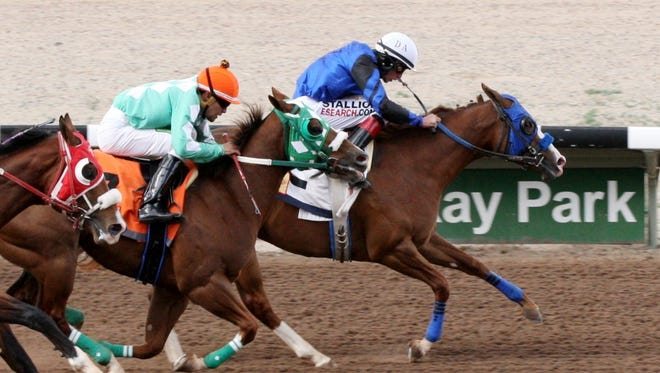 Hard Not To Sing out duels Genuine High and Vmr Rebel on her way to victory Friday at SunRay Park and Casino.