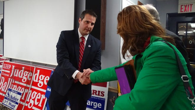 Ray Grogan shook hands with the other applicants Tuesday evening after he was appointed Marion County prosecutor.