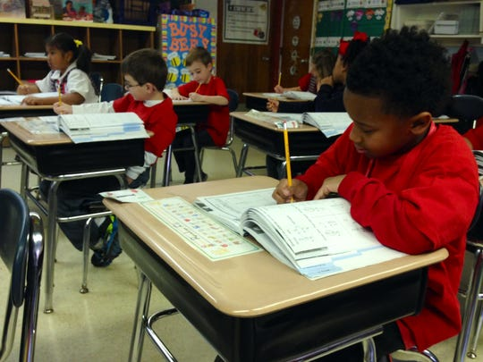St. Frances Cabrini School first-grader Braylon Eli and his classmates do a timed math assignment in Kim Swart's class. The school uses TouchMath curriculum in its lower grades.