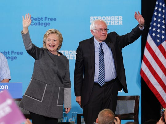 Hillary Clinton and Sen. Bernie Sanders appear at campaign stop at the University of New Hampshire in Durham, N.H., on Sept. 28 2016.