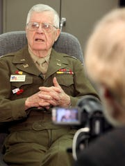 From 2009: World War II veteran Richard Peterson, then 92, of Johnston, wears his U.S. Army uniform while recounting his wartime memories at the Veterans History Project at AIB College of Business.  Stenographers and videographers recorded about 25 veterans' first-hand accounts of their World War II experiences as part of the project.