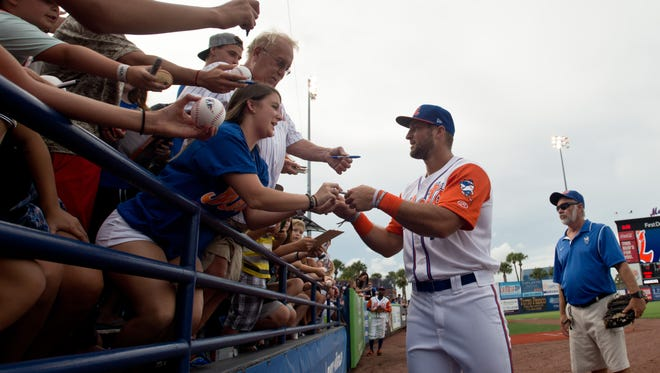 "Tim Tebow greets fans June 28, 2017, before the St. Lucie Mets game against the Palm Beach Cardinals at First Data Field in Port St. Lucie. One hotelier is hoping the ""Tim Tebow effect,"" which smashed St. Lucie Mets attendance records this season, can do the same for hotel occupancy."