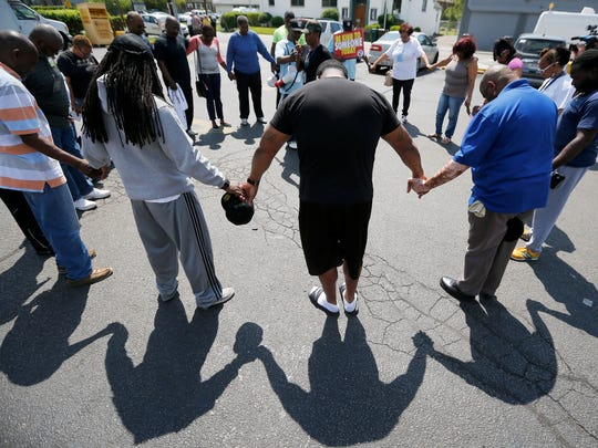 A prayer vigil is held at the corner of Dale and Reading Roads Monday April 25, 2016 for Parris Hummons, 19, of Dayton who was killed April 16 in Bond Hill. The prayer circle is at 5000 Reading Road, the site where Hummons and her friend where found shot.