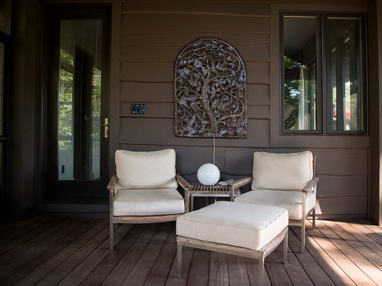 Mark Sinsky and Elizabeth Arrington's home features a large screened-in porch with plenty of seating.