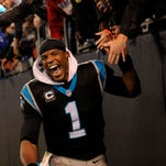 Nov 2, 2015; Charlotte, NC, USA; Carolina Panthers quarterback Cam Newton (1) celebrates after beating the Indianapolis Colts in overtime during the game at Bank of America Stadium. Panthers win 29-26. Mandatory Credit: Sam Sharpe-USA TODAY Sports