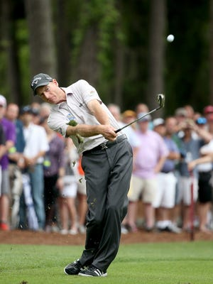 Jim Furyk hits a shot on the 15th hole in the final round of the RBC Heritage at Harbour Town Golf Links in Hilton Head Island, S.C. Furyk birdied two playoff holes to beat Kevin Kisner.