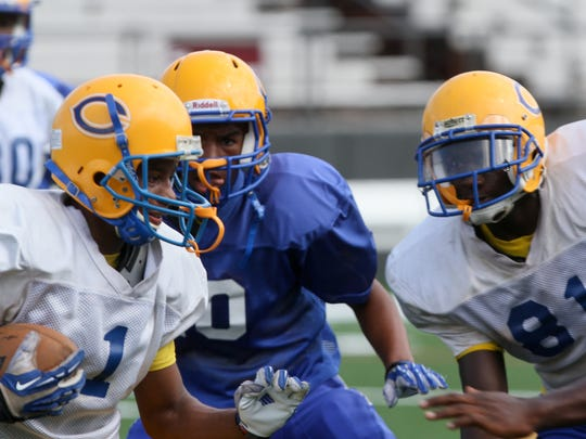 Carroll High School's football team practices on JPS Field at the University of Louisiana at Monroe's Malone Stadium Tuesday in preparation for the upcoming season.