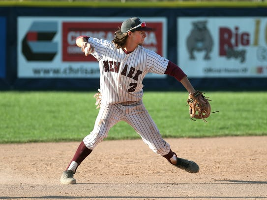 Newark shortstop Ben Cowles makes a throw to first