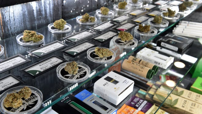 An assortment of cannabis products fills a display case in the showroom of the Buds & Roses dispensary in Studio City, California.