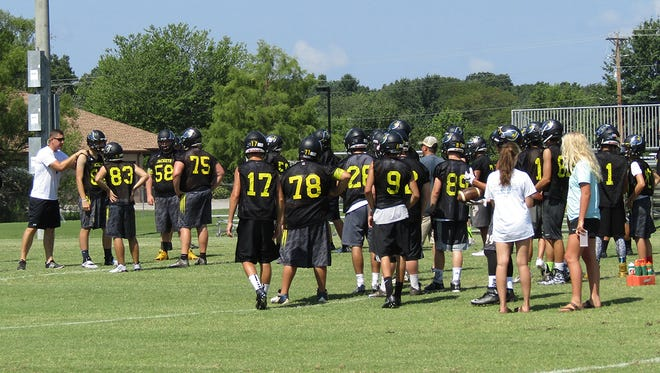 Fairview High Yellow Jackets on the football practice field.