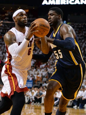 Heat forward LeBron James drives past Pacers center Roy Hibbert in Game 4.