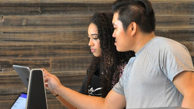 Kung Fu Tea, franchise owner, Tony Nguyen, center, and bartenders, Jasmine Moore and Jennifer Hou prepare for the tea and coffee shop's soft opening. Nguyen said the store's soft open will be Thursday.