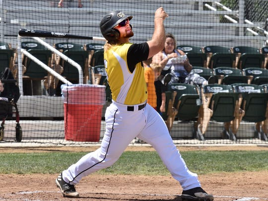 The Colt 45s' Wilson Kessel admires his second inning home run after it left his bat Sunday at Tiger Field. The Colt 45s beat the Auburn Wildcats 9-3.