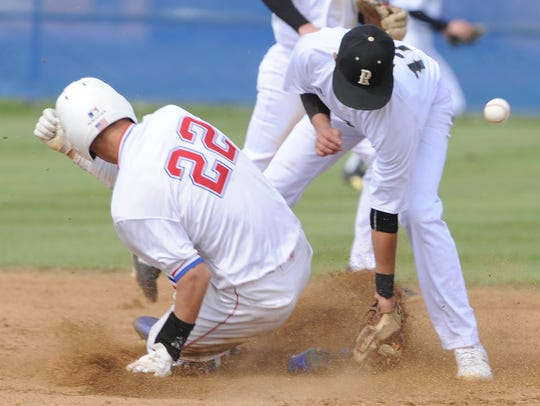 Cooper's Jared Rodgriguez (22) steals second base as