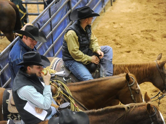 People watch the competition at the Abilene Winter Circuit Cutting at the Taylor County Expo Center Monday, Jan. 2, 2017.