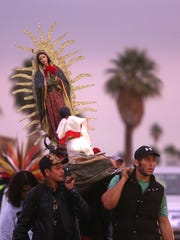 The devout march in the annual Our Lady of Guadalupe procession, which started early Friday in Palm Springs and proceeded through the valley to the city of Coachella.