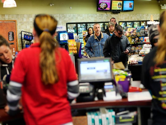 The line for lottery tickets stretches through the store at Rutter's in York on Wednesday. The Powerball drawing is for a record $1.5 billion.