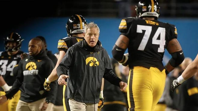 Iowa head football coach Kirk Ferentz celebrates a touchdown with his players against USC during the Holiday Bowl on Dec. 27 at the SDCCU Stadium in San Diego, Calif.