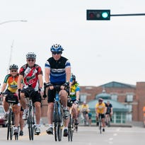Bicyclists ride on Dousman Street during the first Open Streets Green Bay event in 2013.