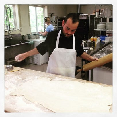 Chef Doran Brooks works with pastry dough. The chef