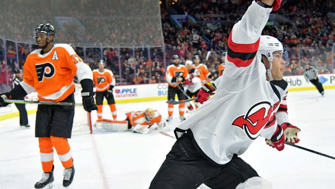 Feb 13, 2018; Philadelphia, PA, USA; New Jersey Devils left wing Taylor Hall (9) celebrates his goal late in the third period against the Philadelphia Flyers at Wells Fargo Center. Mandatory Credit: Eric Hartline-USA TODAY Sports