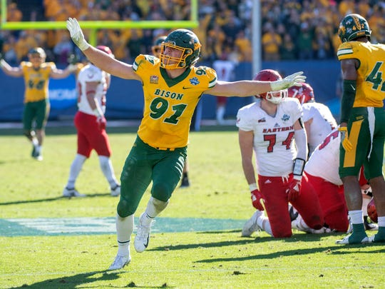 North Dakota State defensive end Derrek Tuszka (91) waves his arms after sacking Eastern Washington quarterback Eric Barriere in the final minutes of the 2019 FCS championship game, in Frisco, Texas.