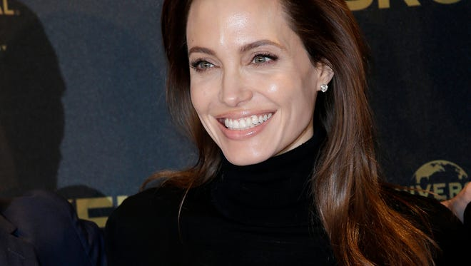 Angelina Jolie has come down with chicken pox, she says.