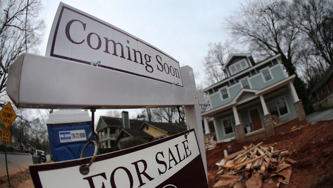 "In this Tuesday, Jan. 26, 2016, photo, a ""For Sale"" sign hangs in front of a home under construction in Atlanta. On Wednesday, Feb. 17, 2016, the Commerce Department reports on U.S. home construction in January."