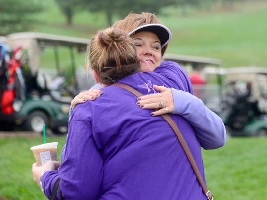 """Crystal Strous, facing, is embraced by Vikki Glogg before the start of the """"Fly High 22"""" memorial golf tournament in honor of Strous' daughter, Amanda, at Heritage Hills Golf Resort on Saturday, Oct. 14, 2017. Amanda, a Dallastown graduate, was murdered in June of 2016 in her North Carolina apartment."""