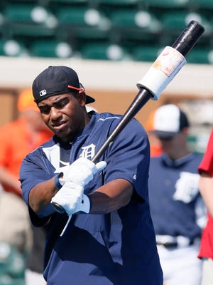 Detroit Tigers outfielder Yoenis Cespedes take some practice swings before the Grapefruit League opener against the Baltimore Orioles today at Joker Marchant Stadium in Lakeland, Fla.
