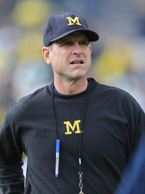 Michigan football coach Jim Harbaugh looks on before a game against Michigan State on Oct. 17, 2015, in Ann Arbor.