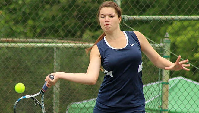 Blackman's Anna Mincey returns a shot during the Region 4-AAA doubles tournament.