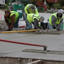 Construction crews pour concrete at the intersection of Whiterock and Moreland in Waukesha Thursday, Oct. 20, 2016. Numerous project throughout the city have forced drivers to navigate a myriad of detours this summer.