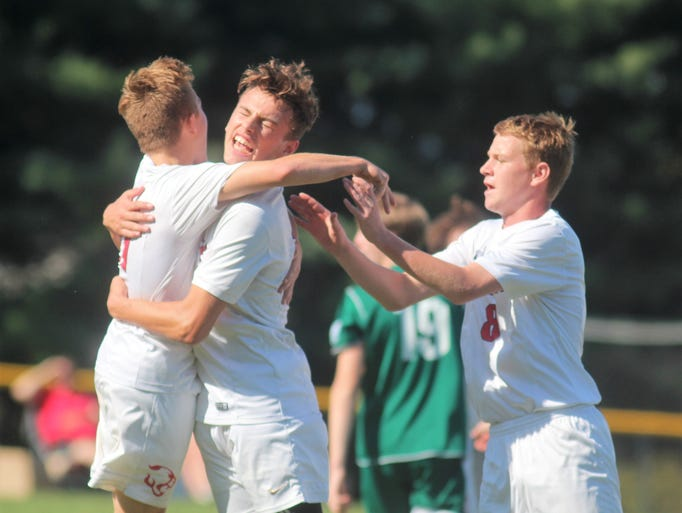Calvary players celebrate a goal by Alec Lockard middle,