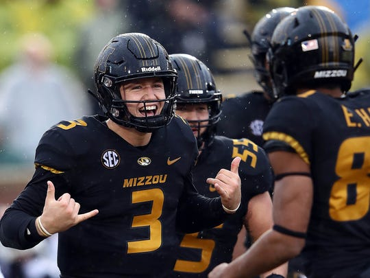 Quarterback Drew Lock #3 of the Missouri Tigers celebrates with teammates after scoring a touchdown during the game against the Arkansas Razorbacks at Faurot Field/Memorial Stadium on November 23, 2018 in Columbia, Missouri. (Photo by Jamie Squire/Getty Images)