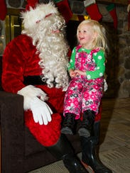 Emersyn Schmit of Sussex visits with Santa at a past