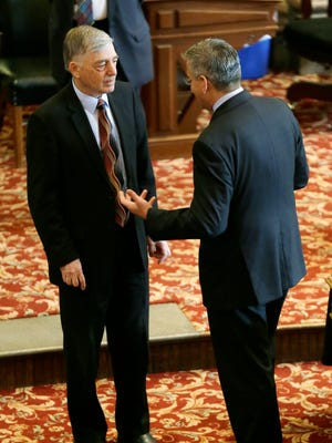 Sen. Julian Garrett, R-Indianola, left, talks with Sen. Matt McCoy, D-Des Moines, after the Senate adjourned, Friday, May 2, 2014, at the Statehouse in Des Moines. The Senate adjourned for the year on Friday, officially putting an end to the 2014 legislative session 10 days past the anticipated April 22 end date.
