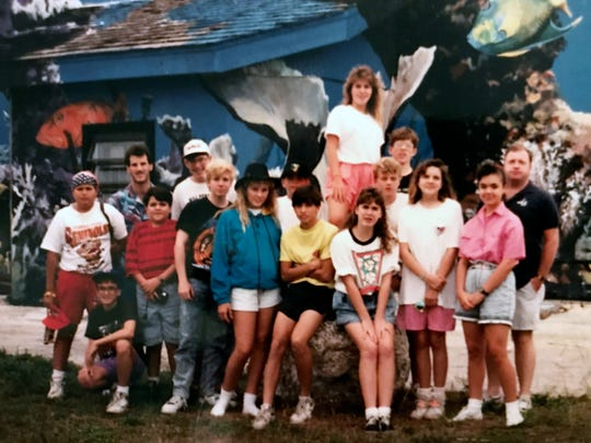 The eighth grade class of Divine Mercy Catholic School in the summer of 1991 in the Florida Keys. Teacher and chaperone Scott Guisbert is seen back row, left. Daddy Duty columnist Tim Walters is crouching in front of him.