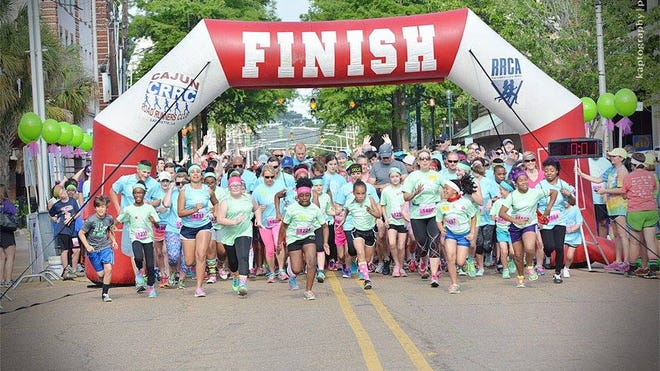 Runners take off at the beginning of the Girls on the Run 5K Saturday in downtown Lafayette in 2015.