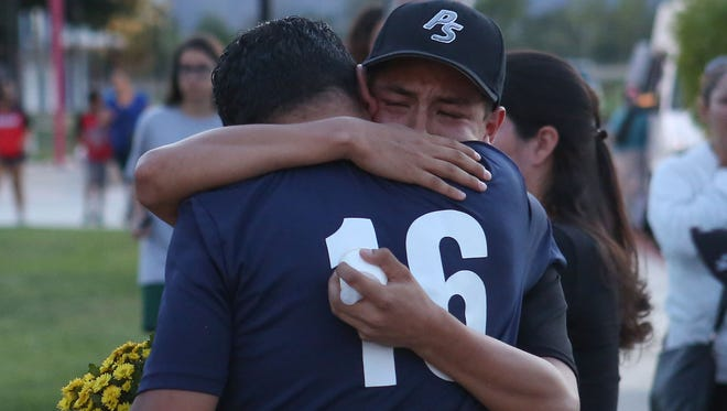 Friends remember 13-year-old Jarrod Dougherty who played youth baseball for the Bombers during a vigil at Demuth Park in Palm Springs, May 8. 2017.