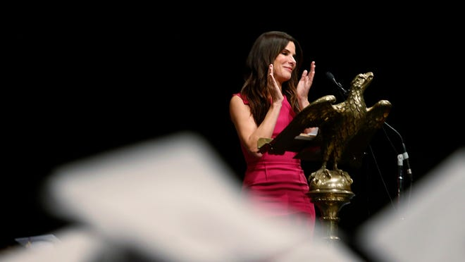 Sandra Bullock addresses Warren Easton Charter High School's graduating seniors Monday, May 19, 2014, in New Orleans. (AP Photo/NOLA.com The Times-Picayune, Kathleen Flynn)  ORG XMIT: LAORS103
