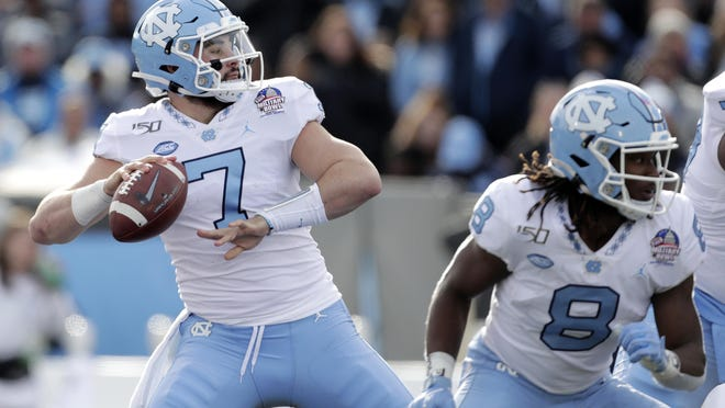 North Carolina quarterback Sam Howell, loading up here in the Military Bowl, threw a school-record 38 touchdown passes last season as a true freshman.