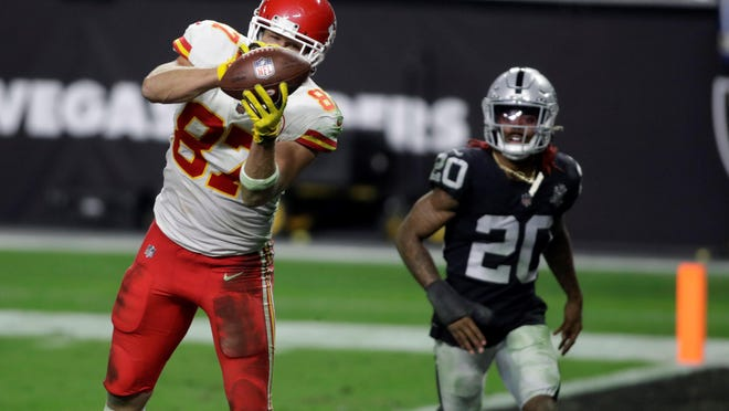 Kansas City Chiefs tight end Travis Kelce (87) catches the winning touchdown pass with 28 seconds left against the Las Vegas Raiders on Sunday night in Las Vegas.