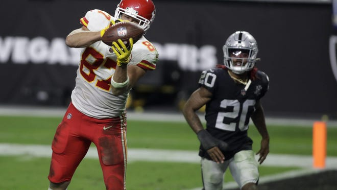 Kansas City Chiefs tight end Travis Kelce (87) catches the game-winning touchdown pass with 28 seconds left as the Chiefs rallied to beat the Las Vegas Raiders 35-31 on Sunday night.