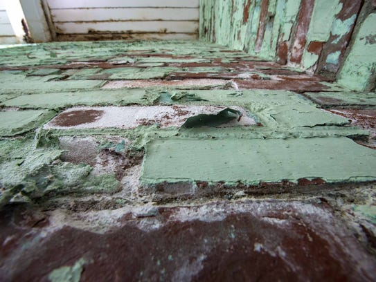 Discolored wood and peeling paint indicate where water
