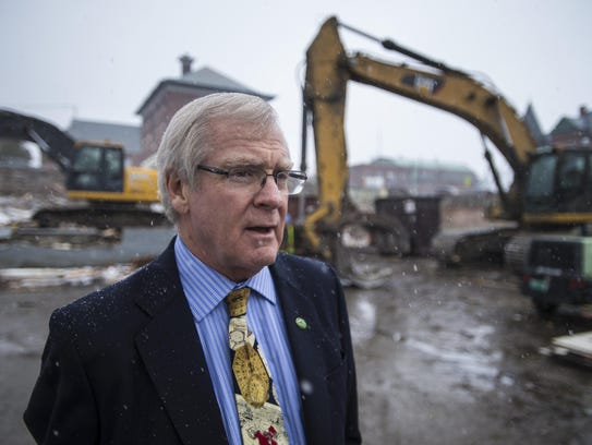 Bill Stenger at the scene of a now-stalled redevelopment