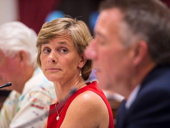 Democratic candidate Sue Minter, center, listens as